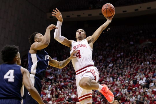 Indiana forward Trayce Jackson-Davis (4) shoots over Penn State forward Seth Lundy (1) in the first half of an NCAA college basketball game in Bloomington, Indiana on Feb. 23, 2020.
