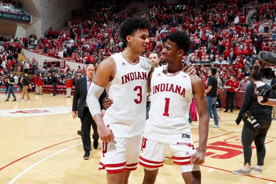 Indiana Hoosiers forward Justin Smith (3) and guard Aljami Durham (1) walk off the court together after the win against the Penn State Nittany Lions at Simon Skjodt Assembly Hall.