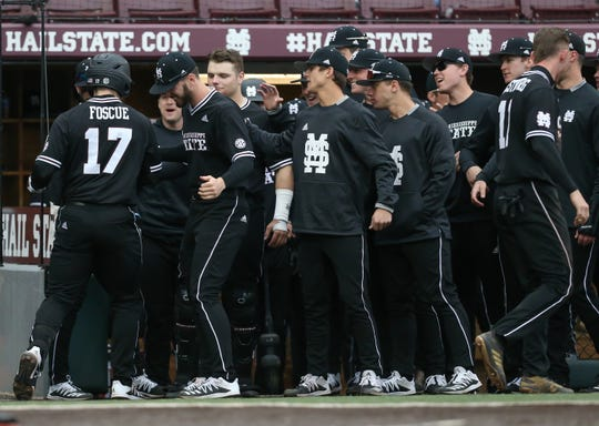 Terammates congratulate Mississippi State's Justin Foscue (17) after he hit a solo home run. Mississippi State played Oregon State at Dudy Noble Field in game 3 of the series on Sunday, February 23, 2020. Photo by Keith Warren