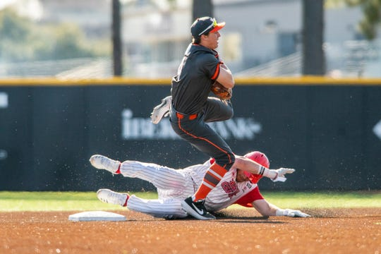 UL outfielder Gavin Bourgeois is tagged out at second base by Virginia Tech shortstop Fritz Genther in the Hokies' 3-2 win over the Ragin' Cajuns on Saturday.