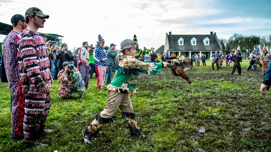 Grant Boudreaux throws the chicken for the Mardi Gras to capture Sunday, Feb. 23, 2020.