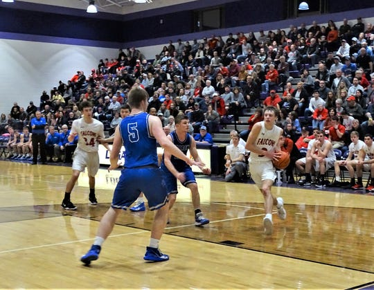 Fairfield Union's Ryan Magill takes the ball to the basket against Warren during the Falcons' 46-43 overtime loss Saturday night.