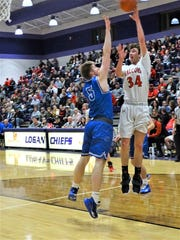 Fairfield Union's Huston Harrah shots a jumper against Warren during the Falcons' 46-43 overtime loss Saturday night.