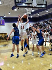 Fairfield Union's Andrew Moll grabs one of his 15 rebounds during the Falcons' 46-43 overtime loss against Warren Saturday night.