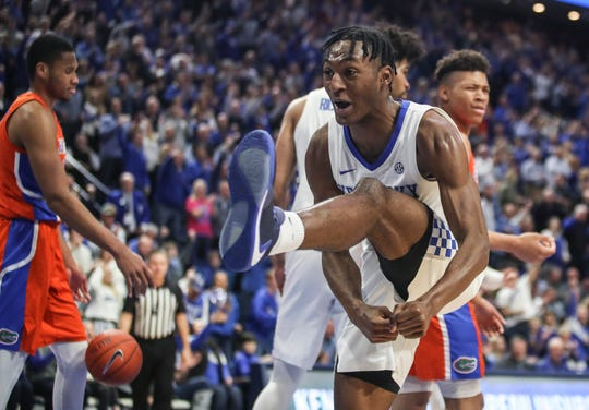 With a high kick, UK's Immanuel Quickley celebrates after scoring two of his 26 points and drawing the foul as the Wildcats beat Florida 65-59 Saturday at Rupp Arena in Lexington. Feb. 22, 2020