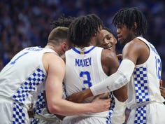 "Kentucky's Immanuel Quickley smiles while huddling with his teammates in the game against Florida. ""I'm with IQ"" said coach John Calipari after Quickley's 26 points performance. ""You know, he's playing."" Feb. 22, 2020"