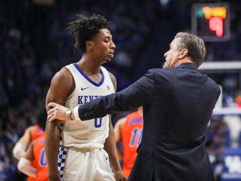 Coach John Calipari has a word with Ashton Hagans during a timeout in the second half. Despite Florida rallying back within the last minute of the game,  the Wildcats beat Florida 65-59 Saturday at Rupp Arena in Lexington. Feb. 22, 2020