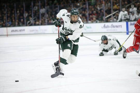 Michigan State senior defenseman Butrus Ghafari goes after the puck against Ohio state on Saturday, February 22 at Munn Ice Arena. The Spartan lost to the Buckeyes 4-2.