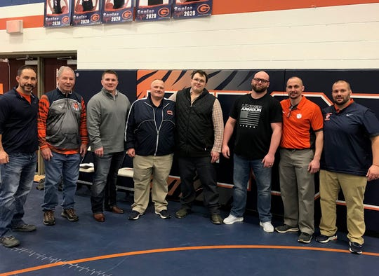 As part of the 50th anniversary of Galion's wrestling program, alums came back from all over the country. Pictured here, left to right, are Brady Wegesin, former state placer and now one of the top officials in Ohio; his dad Jim Wegesin, former head coach (now assistant) with his state champ Ryan Hieber; Galion AD and former coach Kyle Baughn with his state champ, 2-time heavyweight champ and NCAA champ Dustin Fox; state champ Matt Clum with his coach Matt Tyrrell and current head coach Brent Tyrrell.