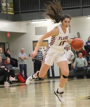 Willard's Cassie Crawford makes a move to the basket during the Lady Flashes' win over Mansfield Senior on Saturday night.