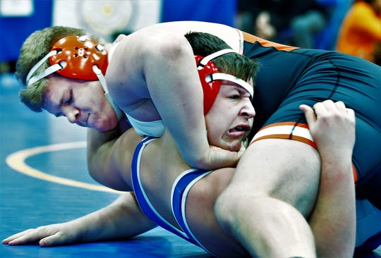 Ashland's Jake Bever control's Collin Gardner of team champion West Holmes en route to the heavyweight title in Saturday's Ohio Cardinal Conference wrestling tournament.