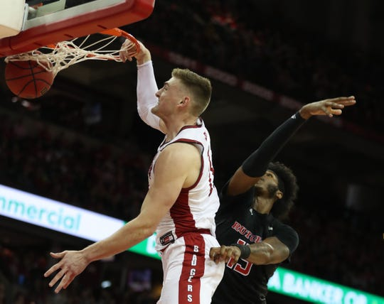 Badgers forward Micah Potter rises for a dunk in front of Myles Johnson of Rutgers on Sunday.