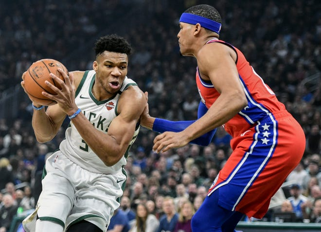 The Bucks' Giannis Antetokounmpo drives to the basket against the Philadelphia 76ers earlier this season. The Bucks had a five-on-five practice Monday for the first time since the NBAshut down in mid-March.