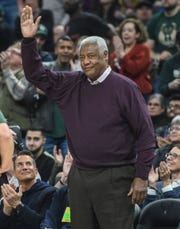 Former Bucks great and NBA legend Oscar Robertson waves to fans at Fiserv Forum after being introduced during Milwaukee's game against the 76ers.