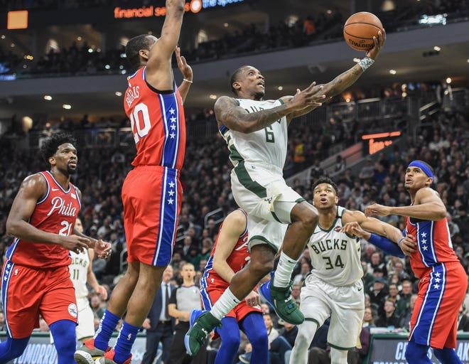 Bucks guard Eric Bledsoe goes up for a layup in fron of 76ers guard Alec Burks in the second quarter.