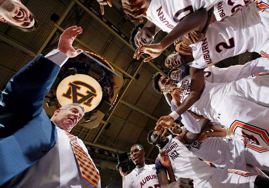 Auburn coach Bruce Pearl dances with his players after beating Tennessee on Saturday, Feb. 22, 2020 in Auburn, Ala.