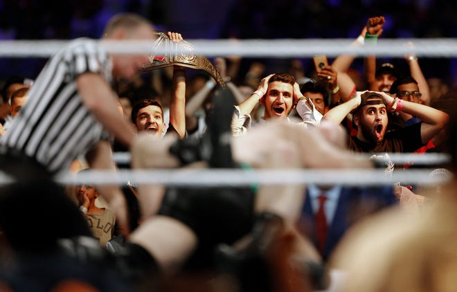 In this Thursday, Oct. 31, 2019 photo, Saudi fans shout during a wrestling match of the WWE Crown Jewel matches at King Fahd International Stadium in Riyadh, Saudi Arabia. Prince Abdulaziz bin Turki al-Faisal, who leads the General Sports Authority, said during an interview with the Associated Press that he invites anyone who's interested or curious about Saudi Arabia to come and visit the country after it opened tourist visas to people from around the world . (AP Photo/Amr Nabil)