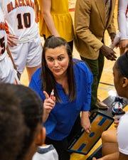 Blackman coach Wendi Scott talks to players during Saturday's 7-AAA semifinals.