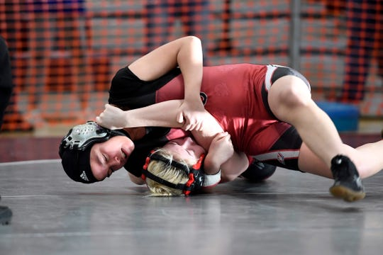 Stephanie Andrade of Hunterdon Central, top, wrestles Amanda Connors of Northern Highlands in the 128-pound final during the North Region girls wrestling tournament on Sunday, Feb. 23, 2020, in Union.