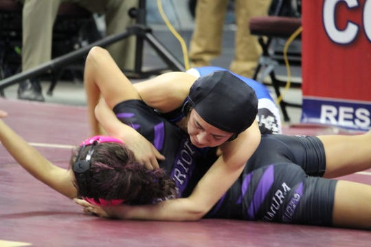 Oñate senior Angelita Altamirano won the first girls wrestling state championship on Saturday in Rio Rancho.