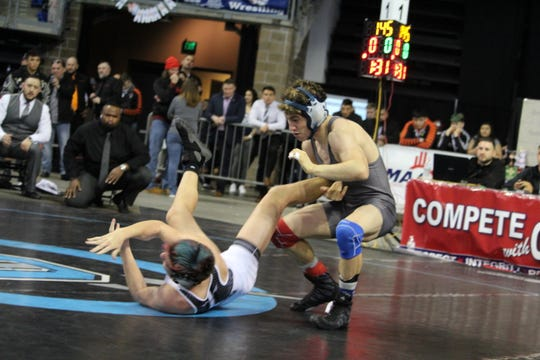 Las Cruces High's David Graves beat Johnny Herrerra of Volcano Vista to win his first state wrestling title.