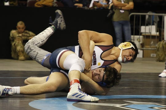 Deming's Jesse Daniel Perez tries to pin Carlsbad's Justin Wood in their 5A 160-pound championship match in the New Mexico state wrestling tournament in Rio Rancho on Feb. 22, 2020. Perez won via major decision, 16-8.