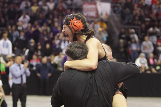 Aztec's Mia Aguirre celebrates defeating Atrisco Heritage's Yalixza Gonzalez for the Girls 120-pound division title during Saturday's New Mexico State Wrestling Championships at the Santa Ana Star Center in Rio Rancho.
