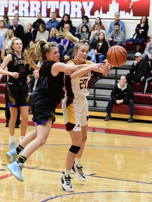 Marian used defense to its advantage in the playoff opener against Seaholm Monday, a file photo of the Catholic League title game against Mercy.