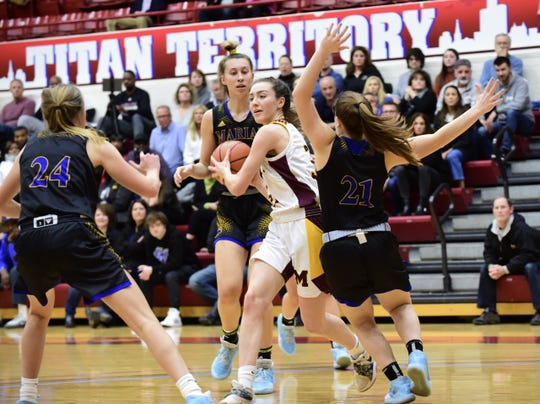 Mercy guard Maddie Kenny looks to make a pass against Marian in the Catholic League title game.