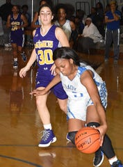 A North Central player scrambles to recover a loose ball against Opelousas Catholic earlier this season. The No. 1 Hurricanes play at home Monday against Plain Dealing in a 6 p.m. Class 1A playoff game.