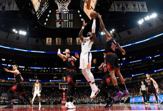Feb 22, 2020; Chicago, Illinois, USA; Phoenix Suns center Deandre Ayton (22) is defended by Chicago Bulls forward Thaddeus Young (21) and guard Zach LaVine (8) during the first half at United Center. Mandatory Credit: David Banks-USA TODAY Sports