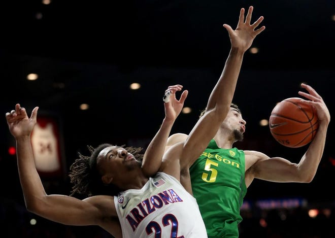 Arizona forward Zeke Nnaji (22) loses the battle for a rebound to Oregon guard Chris Duarte (5) in the first half of their Pac-12 game at McKale Center, February 22, 2020 Tucson, Ariz.