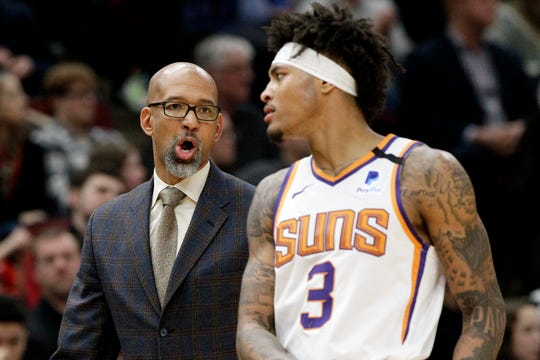 Phoenix Suns head coach Monty Williams, left, talks to forward Kelly Oubre Jr., during the second half of an NBA basketball game against the Chicago Bulls in Chicago, Saturday, Feb. 22, 2020. (AP Photo/Nam Y. Huh)
