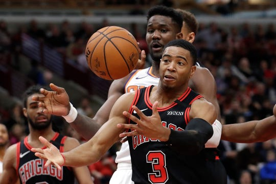 Chicago Bulls guard Shaquille Harrison (3) battles for a rebound against Phoenix Suns center Deandre Ayton during the second half of an NBA basketball game in Chicago, Saturday, Feb. 22, 2020. (AP Photo/Nam Y. Huh)