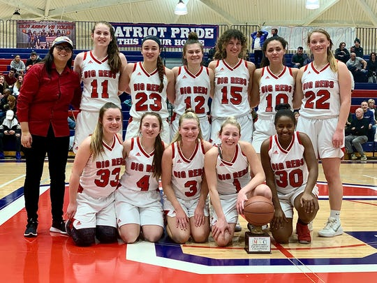 Port Huron celebrates with the championship trophy after beating Grosse Pointe North in the Macomb Area Conference Red/White girls basketball championship on Saturday, Feb. 23, 2020, at Warren Cousino.