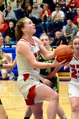 Port Huron's Emma Trombly attempts a layup against Grosse Pointe North in the Macomb Area Conference Red/White girls basketball championship on Saturday, Feb. 23, 2020 at Warren Cousino.