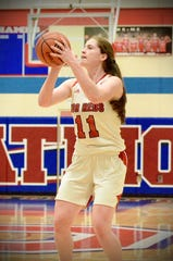 Port Huron's Emma Trombly shoots a 3-pointer against Grosse Pointe North in the Macomb Area Conference Red/White girls basketball championship on Saturday, Feb. 23, 2020, at Warren Cousino.