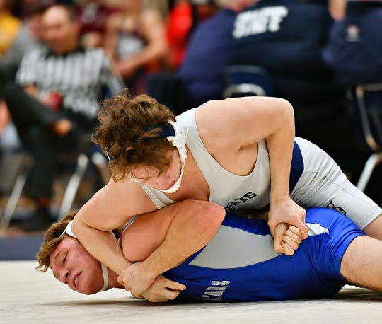 Dallastown's Brooks Gable, top, wrestles Garden Spot's Gunner Gehr in the 145 pound weight class during PIAA District III, Class 3-A wrestling championships at Spring Grove Area High School in Jackson Township, Saturday, Feb. 22, 2020. Gable would win 7-0 by decision. Dawn J. Sagert photo