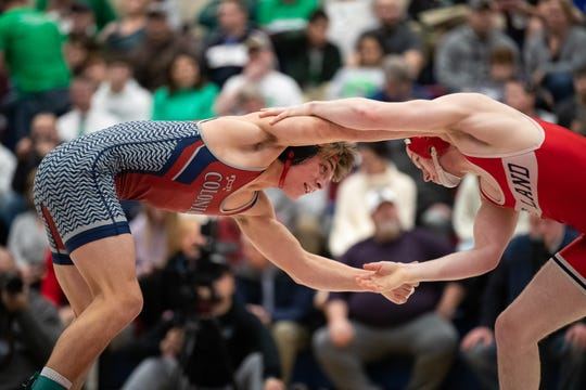 New Oxford's Timothy Uhler wrestles Red Land's Bryce Brennan during finals at the PIAA District 3 3A championships, Saturday, Feb. 22, 2020, at Spring Grove High School.