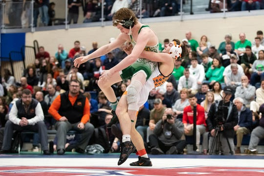 Northeastern's Cole Wilson wrestles Central Dauphin's Josh Miller during finals at the PIAA District 3 3A championships, Saturday, Feb. 22, 2020, at Spring Grove High School.
