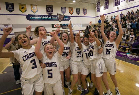 The Spanish Springs team celebrate after winning the class 4A Northern Regional Girls Basketball Championship game in overtime at Spanish Springs High School in Sparks, Nev., Saturday, Feb. 22, 2020.