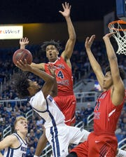 Nevada's Lindsey Drew looks for shooting space against the Fresno State defense on Saturday night.