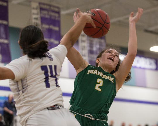 Bishop Manogue Lauren Vasquez (2) shot is blocked by Spanish Springs guard Autumn Wadsworth (14) during the class 4A Northern Regional Girls Basketball Championship game at Spanish Springs on  Saturday.