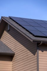 Solar panels have been installed on the roof of Jennifer and Brent Morace at their home in West Salem on Feb. 21, 2020.