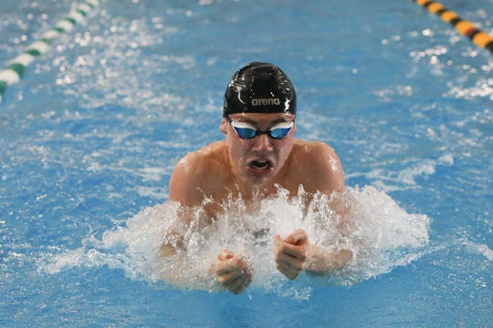 South Salem's Julian Melton placed third in the 100-yard breaststroke at the OSAA 6A swimming state championship at Tualatin Hills Aquatic Center on February 22.