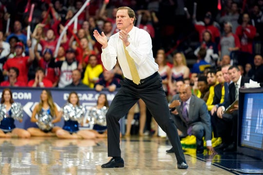 Oregon coach Dana Altman applauds the team during the second half of an NCAA college basketball game against Arizona on Saturday, Feb. 22, 2020, in Tucson, Ariz. Oregon won 73-72 in overtime.