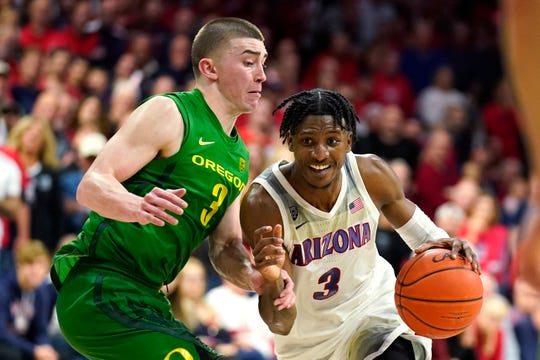 Arizona guard Dylan Smith (3) drives on Oregon guard Payton Pritchard during the second half of an NCAA college basketball game Saturday, Feb. 22, 2020, in Tucson, Ariz. Oregon won 73-72 in overtime.