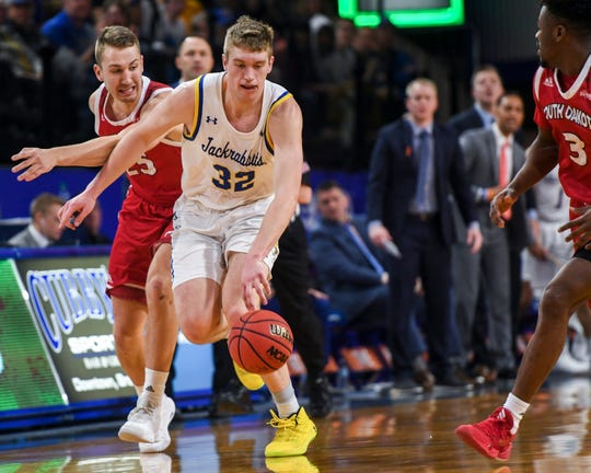 SDSU's Matt Dentlinger (32) dribbles the ball down the court during the game against USD on Sunday, Feb. 23, 2020 at Frost Arena in Brookings, S.D.