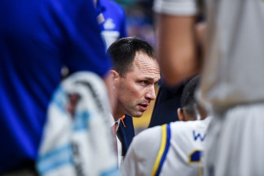 SDSU head coach Eric Henderson talks to his team during a timeout during the game against USD on Sunday, Feb. 23, 2020 at Frost Arena in Brookings, S.D.