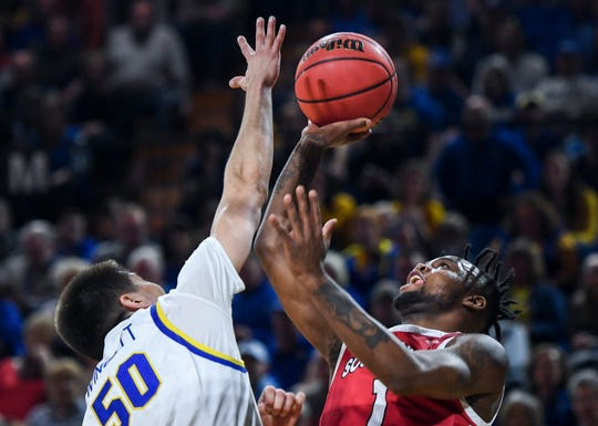 USD's Ty Chisom (1) goes up for a basket during the game against SDSU on Sunday, Feb. 23, 2020 at Frost Arena in Brookings, S.D.